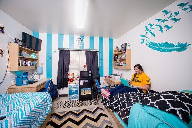 A stylized dorm room.
