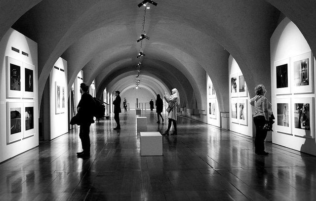 A photography exhibition in a gallery.