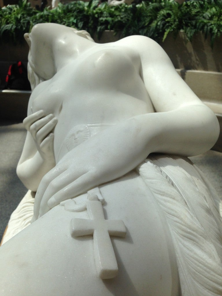 A porcelain figure with the crucifix.