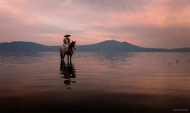 Mexican Cowgirl Riding Her Dancing Horse on Lake Chapala, Mexico
