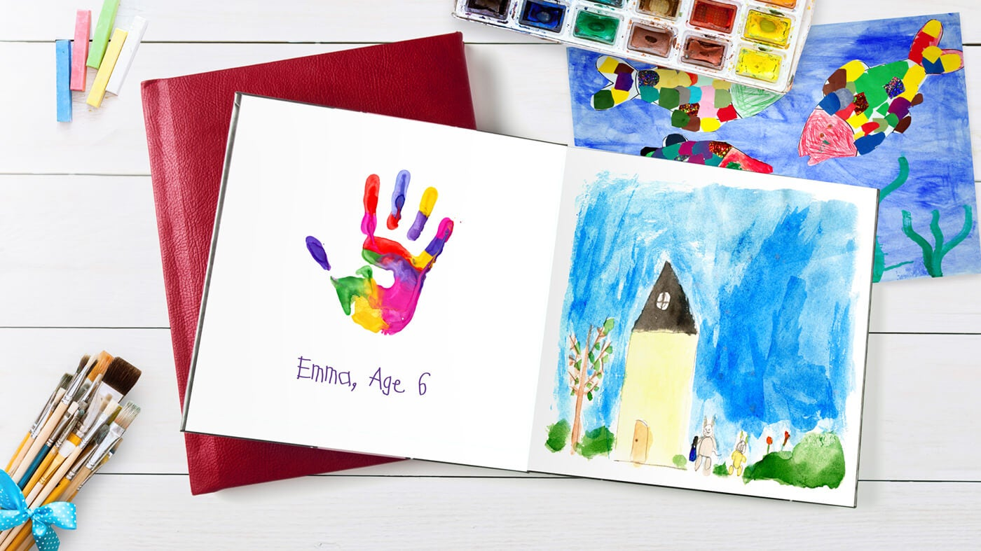 printique by adorama photo book with child's art in it