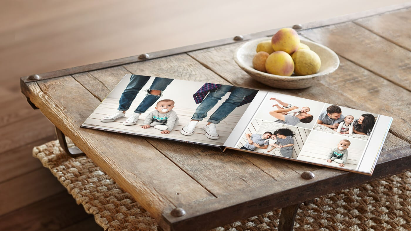 printique by adorama photo book on table showing family