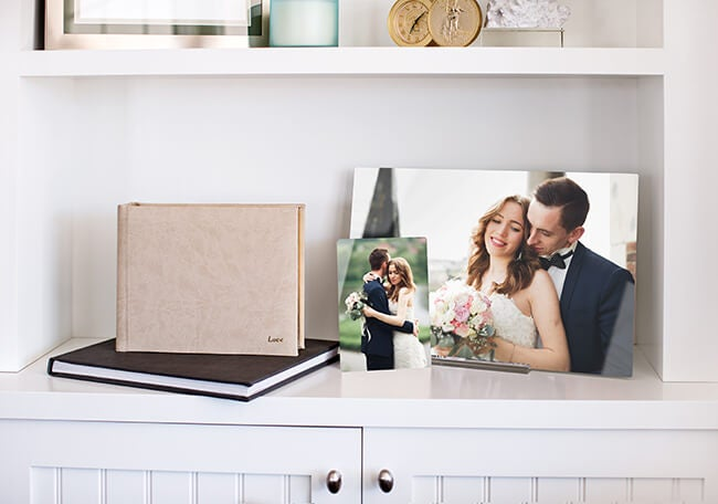wedding photo books manufactured by AdoramaPix and metal on shelf