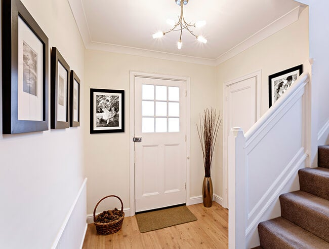 entry way with framed prints manufactured by adoramapix