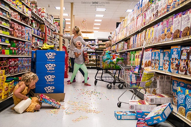 mom and children in grocery aisle