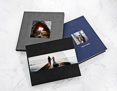 three metal cover photo books by adoramapix