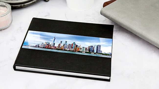 metal cover photo book with skyline on front produced by Printique