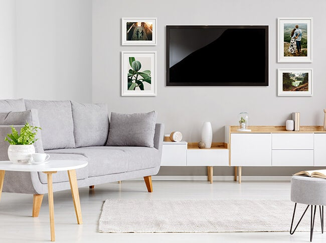 living room wall gallery with television and framed prints by printique