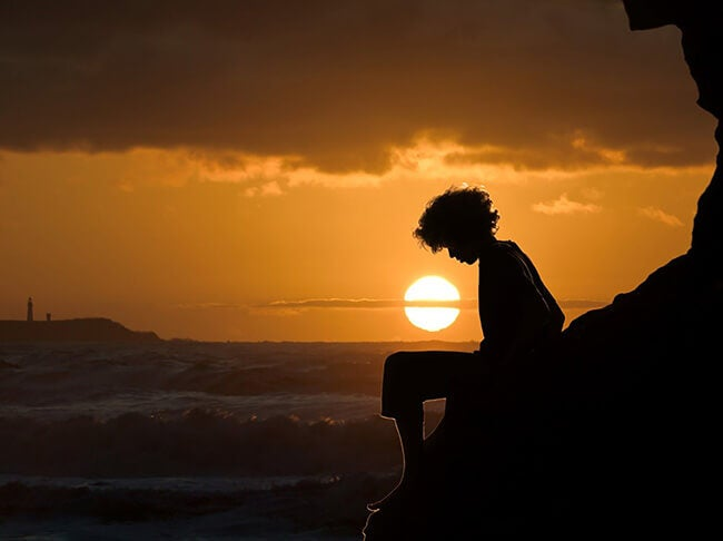 silhouette boy at sunset