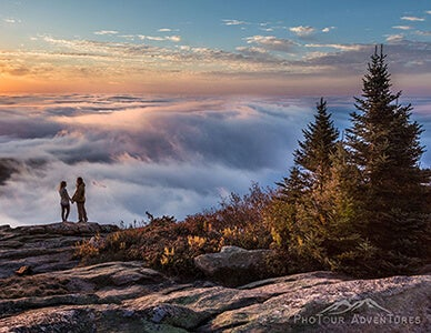 couple on edge of mountain