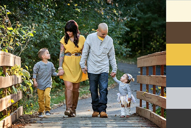 family walking on bridge for fall portrait