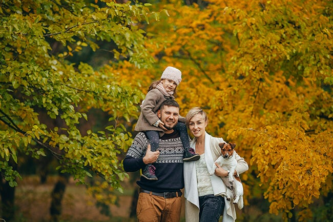 family fall portrait with child and dog