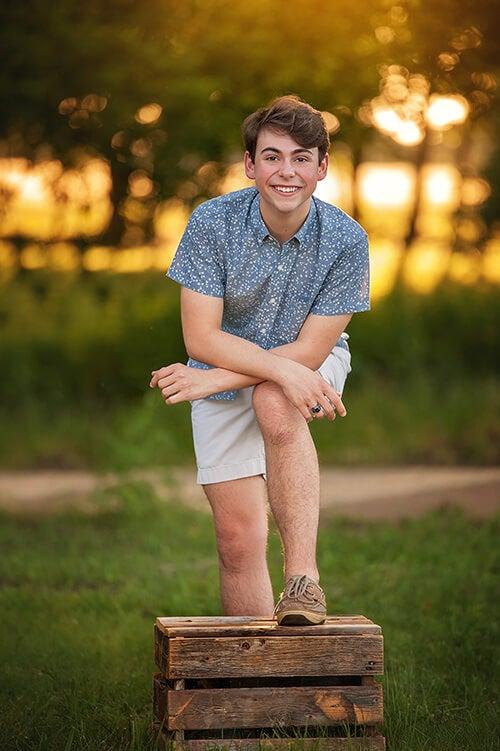 high school senior boy posing