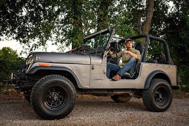 high school senior boy posing in truck