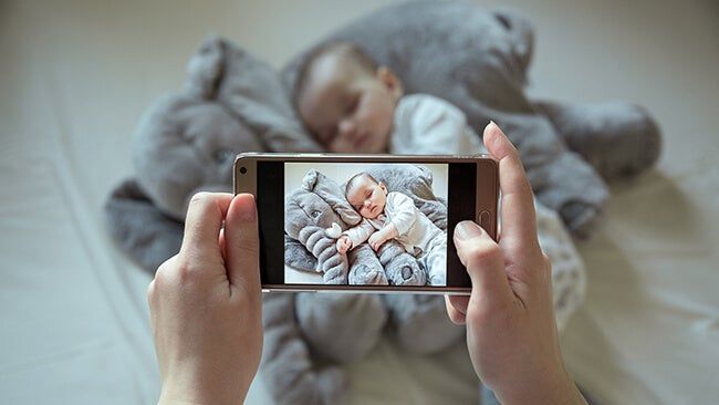 photographing baby with smartphone
