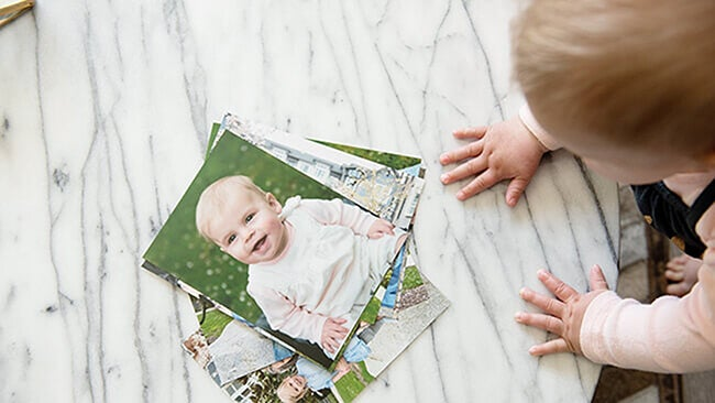 baby looking at Printique  photo