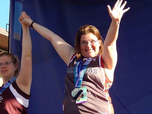 special olympian on podium