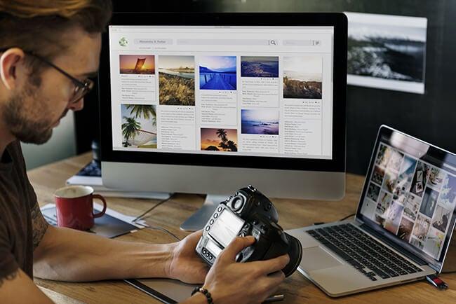 photographer at computer