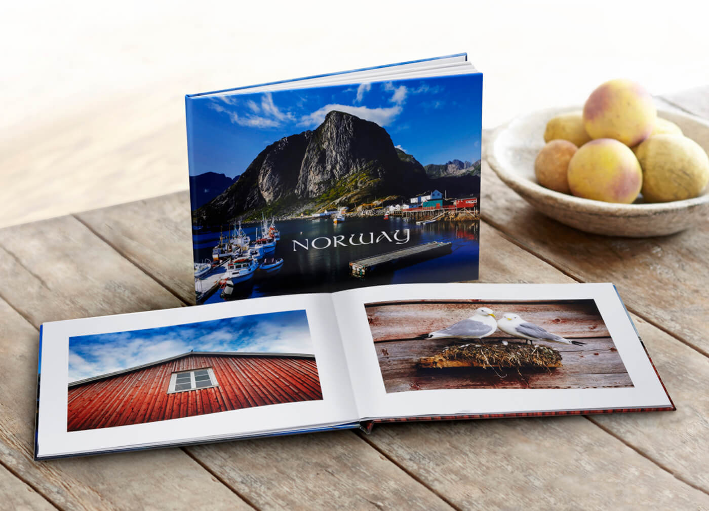 photo book of norway by printique on table