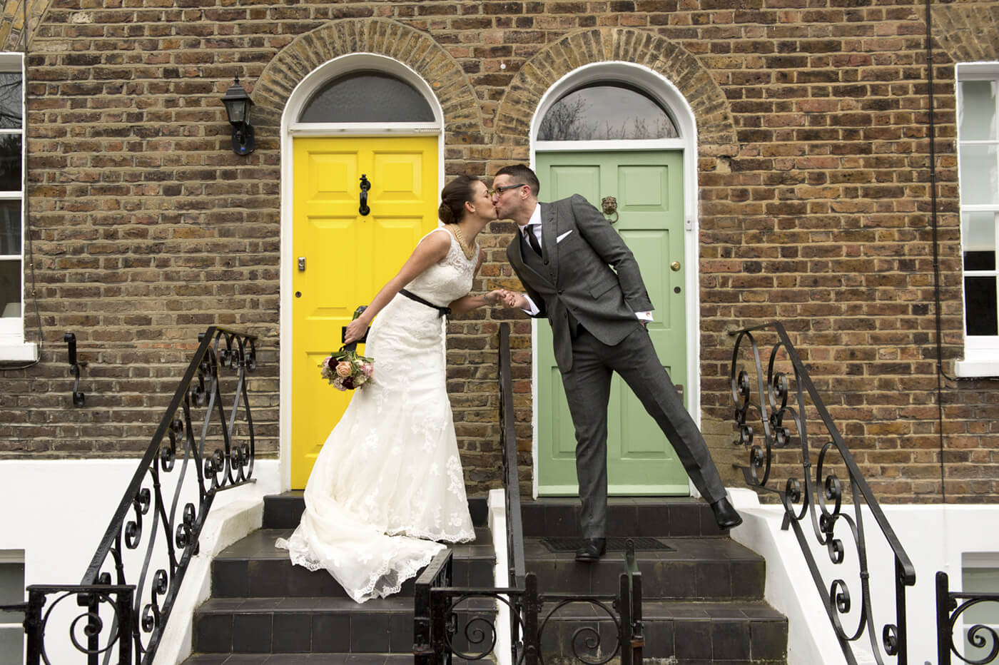 wedding couple on stairs kissing