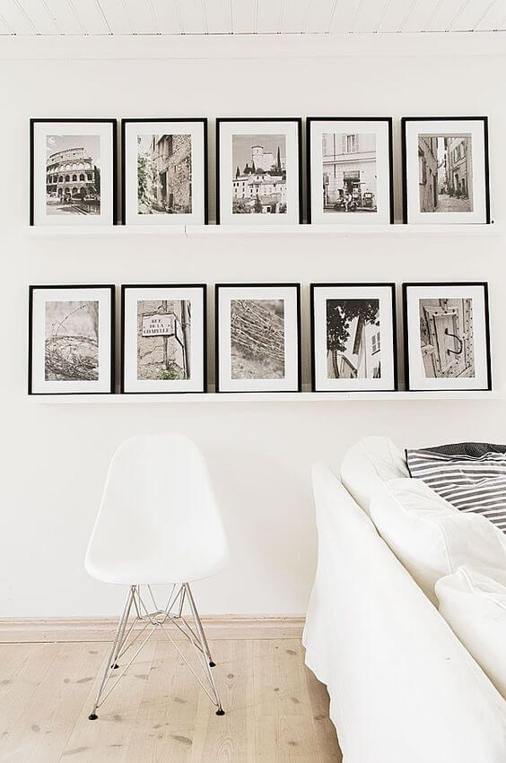 picture ledge with black and white frames manufactured by adoramapix
