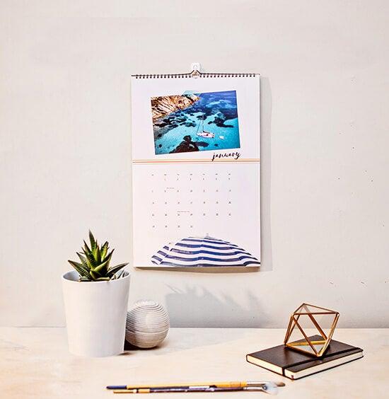 11x16 calendar above desk manufactured by printique