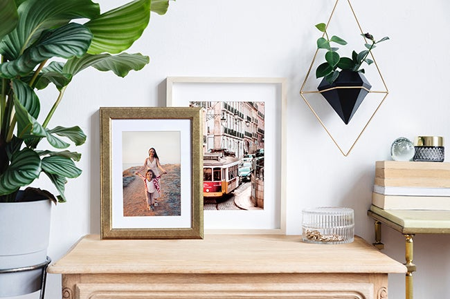 framed prints by Printique  on table